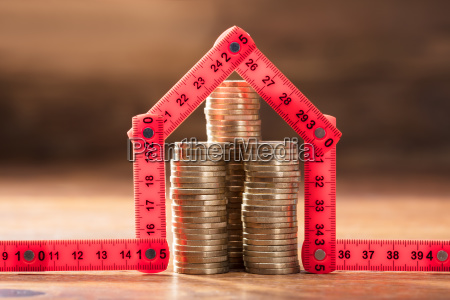 coins stack under the house made