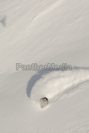 aerial view of snowboarder on snowy