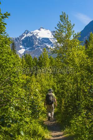 a man hiking at dew pond