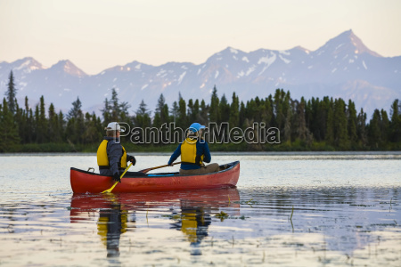 a couple canoeing on stone step