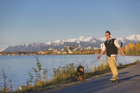 teenage boy riding his skateboard while