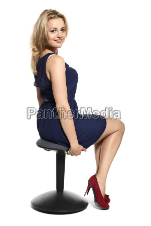 attractive woman sitting on stool