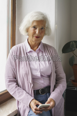 portrait of senior woman with mobile