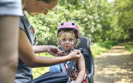 little girl sitting on child seat