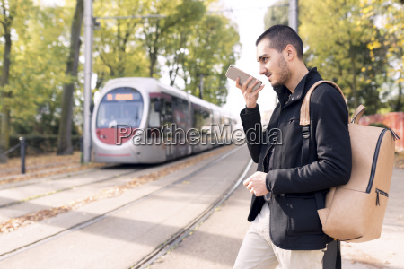 young man with cell phone at