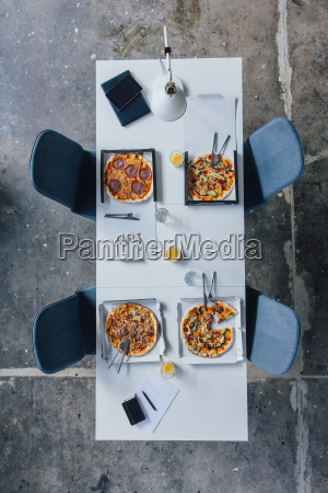 meeting table with pizza