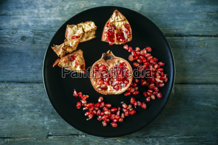 half of pomegranate and pomegranate seed