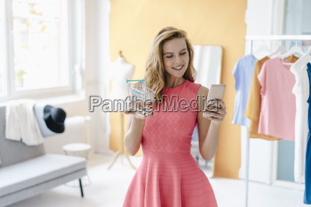 smiling young woman in fashion studio