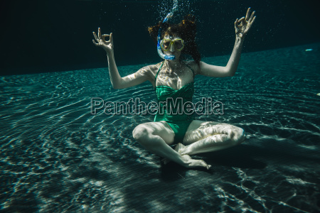 woman with diving goggles and snorkel