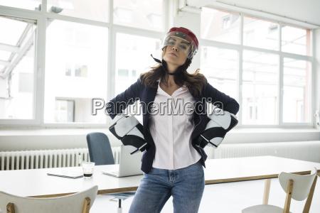 portrait of businesswoman wearing ice hockey