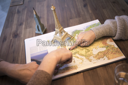 hands on atlas with model of