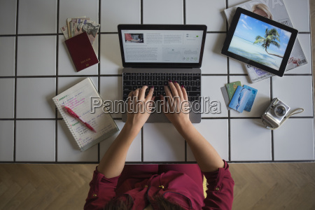 young woman using laptop travel booking
