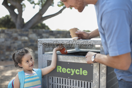 girl with father putting a drink