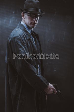 portrait of confident man holding gun