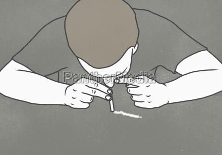 man inhaling drug over gray background