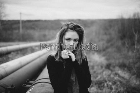 portrait of teenage girl with hands