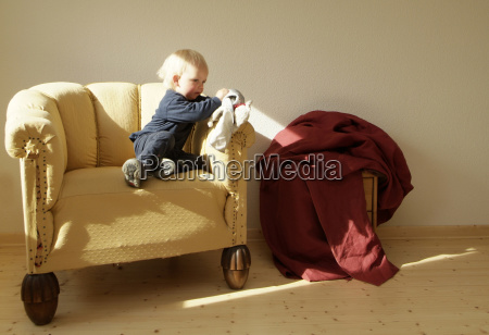 armchair furniture chairs sits boys housing