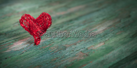 red heart on shabby wood
