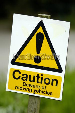 warnschild caution beware of moving vehicles