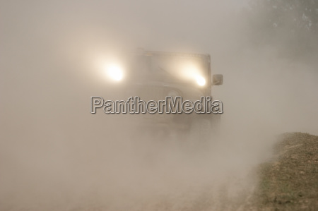 jeep is driving in the dust
