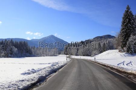 empty road in winter landscape