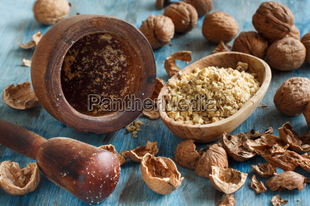 fresh walnuts and mortar on a