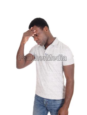 depressed looking african man standing