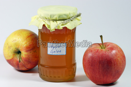 glass of apple jelly and apples