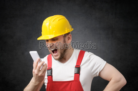 construction worker shouting on the phone