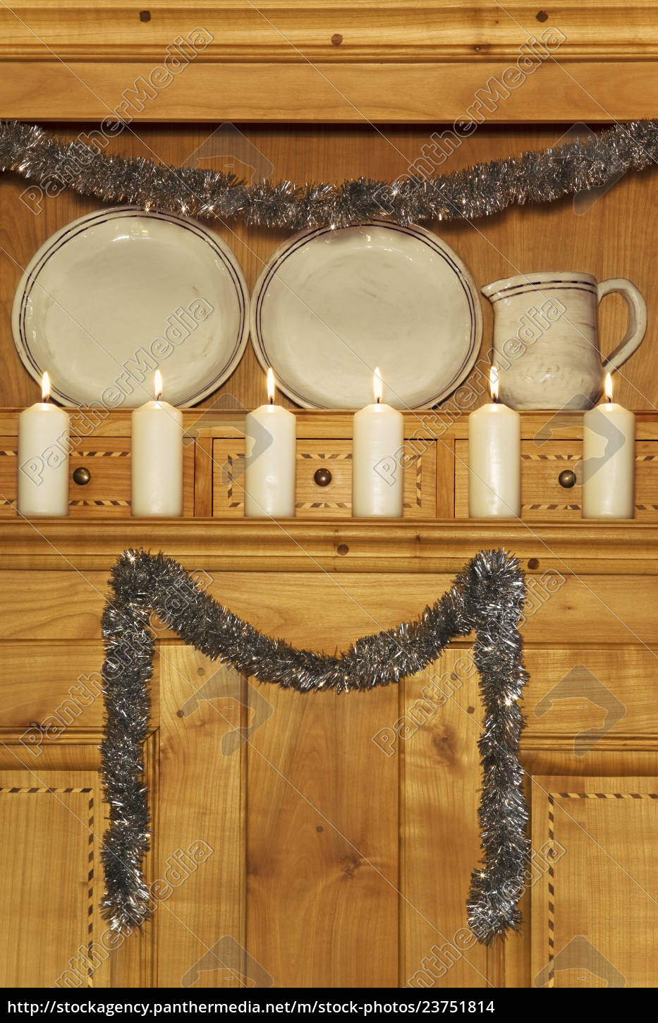 burning, white, candles, on, a, cabinet - 23751814