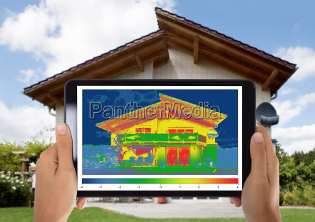person detecting heat loss digital tablet
