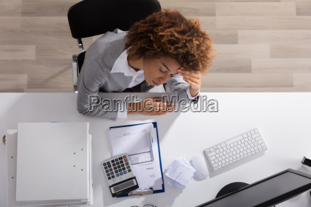 unhappy afro american businesswoman sitting in