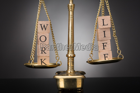 justice scale with wooden blocks showing