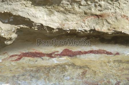 limestone rocks with maori rock painting