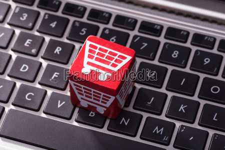 shopping cart symbol block over the