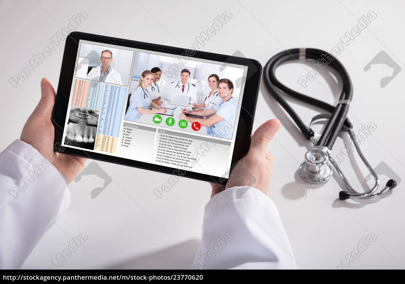 Royalty free photo 23770620 - Doctor Video Conferencing With Medical Team  On Digital Tablet