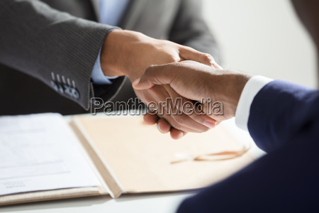 close up of businessperson shaking hand