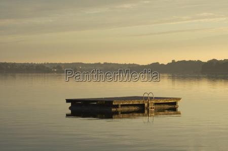 morning sun at lake chiemsee near