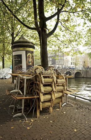 wicker, chairs, of, a, restaurant, piled - 23797704