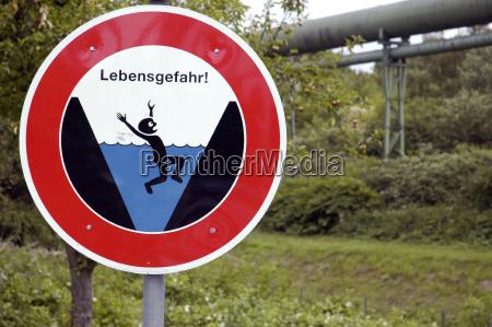sign signal danger stream horizontal signposts