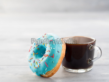 blue donut and coffee on gray
