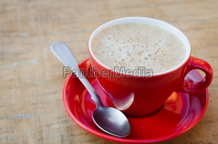 red cup of morning coffee or