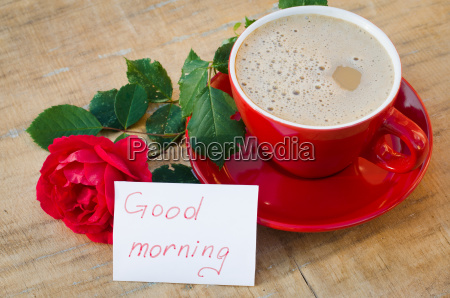 coffee cup with red rose and