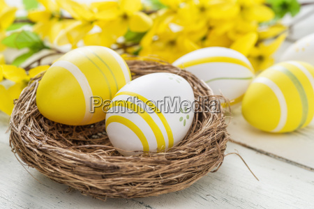 easter basket with yellow easter eggs
