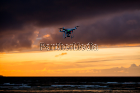 flying drone over sea and cloud