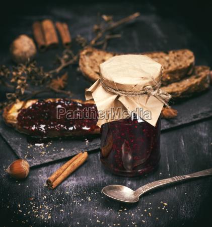 raspberry jam in a glass jar