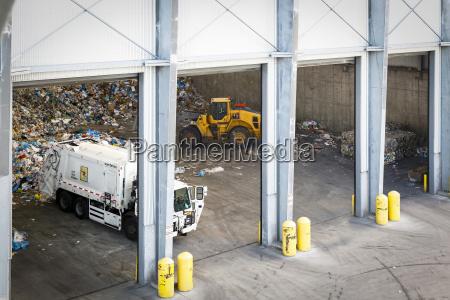 garbage truck unloading trash