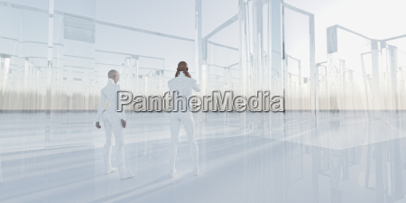 people standing near glass maze