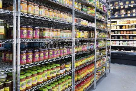 jars of food in supermarket aisle