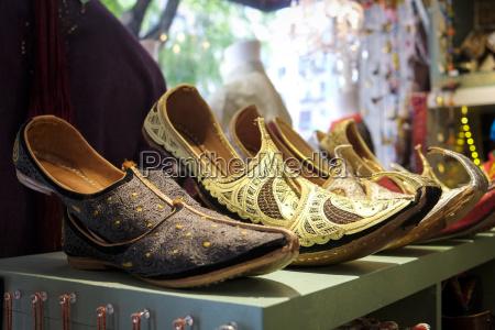 ornate shoes on shelf